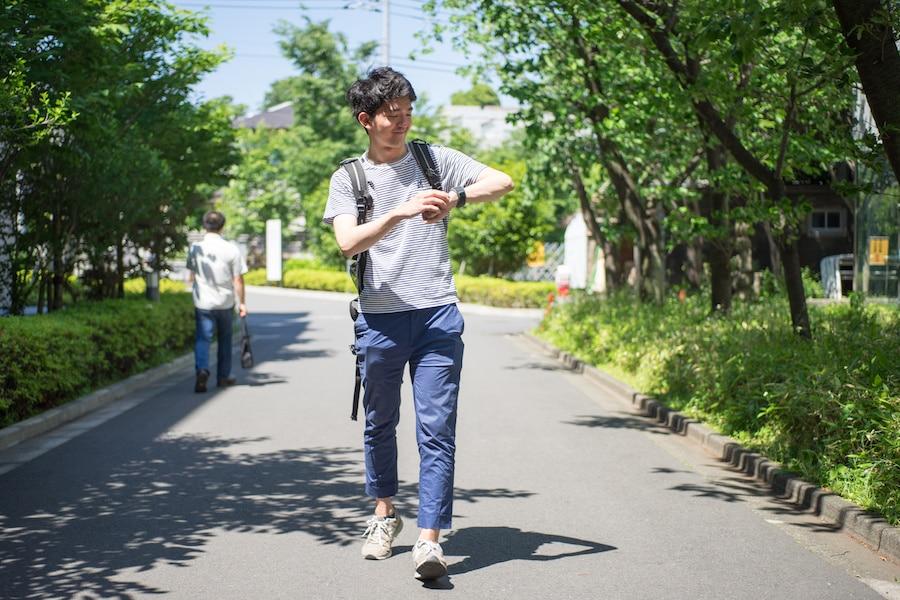 student-walking-watch-outside