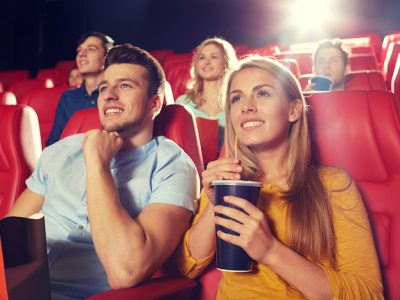 man-woman-watch-movie-theater