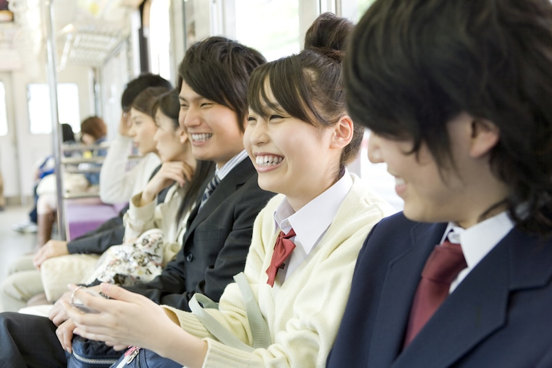 go-home-students-high-school-train-smilimg-sitting