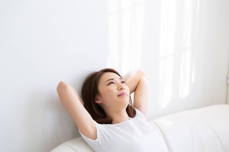 relax-Young-Women-sitting-sofa